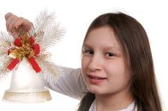 Mädchen mit Weihnachtsglocke Stockfotos