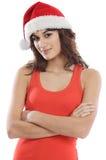 Mädchen mit Weihnachtsmann-Hut Stockfotografie
