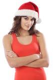 Mädchen mit Weihnachtsmann-Hut Stockbilder