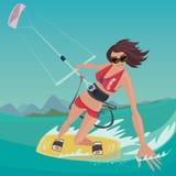Mädchen nimmt an dem Kitesurfing teil Stockbilder