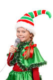 Mädchen - Sankt Elfe mit einem Mikrofon. Stockbild