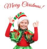 Mädchen - Sankt-` s Elfe, die Zeichen O.K. zeigt stockfotografie