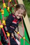 Mädchen am Spielplatz Stockfotografie