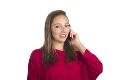 Mädchen spricht durch Handy Lizenzfreies Stockfoto