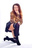 Mädchen steht auf dem einem Knie Stockbilder
