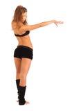 Mädchen steht in der schönen Haltung zurück zu Kamera Stockbild