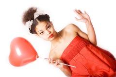 Mädchen u. roter Ballon Stockfotos