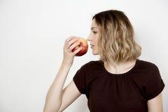 Mädchen und Apfel Lizenzfreies Stockbild