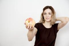 Mädchen und Apfel Stockbilder