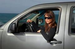 Mädchen und Auto Stockbilder