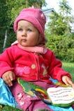 Mädchen und Buch Lizenzfreies Stockbild