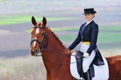 Mädchen und Dressagepferd Stockfoto
