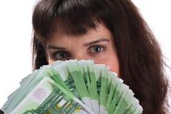 Mädchen und Euro. Stockfotos