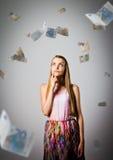 Mädchen und Euro Lizenzfreie Stockfotos