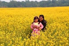 Mädchen- und Frauenlächeln Lizenzfreie Stockfotos