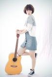 Mädchen und Gitarre Stockfoto