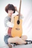 Mädchen und Gitarre Lizenzfreies Stockfoto