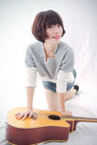 Mädchen und Gitarre Stockfotos