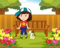 Mädchen und Hund im Garten stock abbildung