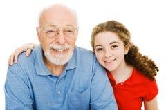 Mädchen und ihr Großvater Lizenzfreies Stockfoto