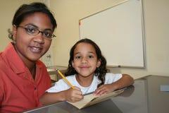 Mädchen und Lehrer Lizenzfreies Stockbild
