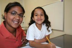 Mädchen und Lehrer Stockfoto