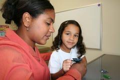 Mädchen und Lehrer Stockbild