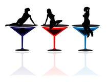 Mädchen und Martini-Gläser Stockfotos