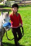 Mädchen und Pony Lizenzfreies Stockbild