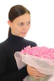 Mädchen und rosafarbene Rosen Lizenzfreie Stockbilder