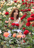 Mädchen und Rosen Stockbilder
