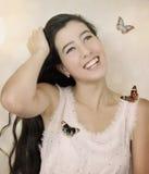 Mädchen und Schmetterlinge Stockbilder