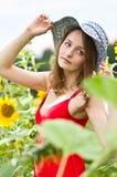 Mädchen und Sonnenblume Lizenzfreies Stockfoto