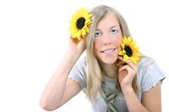 Mädchen und Sonnenblumen Stockfoto