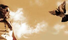 Mädchen und Taube Stockbilder