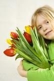 Mädchen und Tulpen Lizenzfreies Stockbild