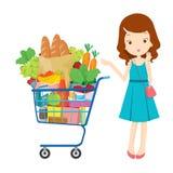 Mädchen und Warenkorb voll des Essens Stockfotografie