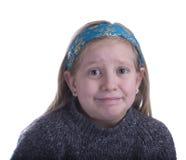 Mädchen verwirrt in einer grauen Strickjacke stockbilder
