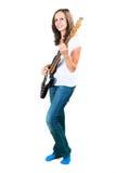 Mädchen, welches die Bass-Gitarre lokalisiert auf Weiß spielt lizenzfreies stockbild