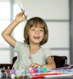 Mädchen zeichnet Stockfotografie
