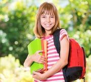 Mädchen zurück zu Schule stockbild