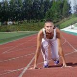 Mädchenanfangslack-läufer Stockfotografie