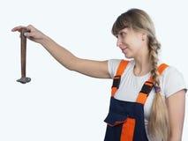 Mädchenarbeitskraft mit dem Werkzeug Lizenzfreies Stockfoto