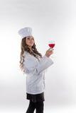 Mädchenchef mit einem großen Glas lizenzfreies stockfoto