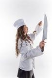 Mädchenchef mit einem großen Messer lizenzfreie stockfotos