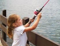 Mädchenfischen Stockfoto