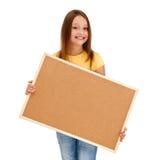 Mädchenholding noticeboard stockbild