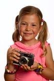 Mädchenholdingkamera Stockbild