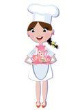 Mädchenkoch mit Teeset Lizenzfreie Stockfotos