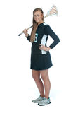 MädchenLacrosse, der mit Steuerknüppel über Schulter steht stockfotografie